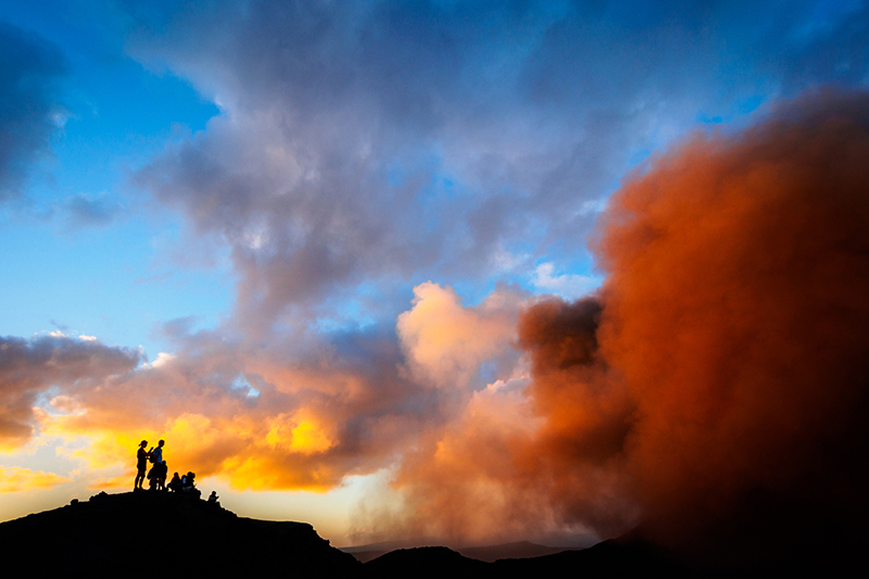 Tourists stand on Mt Yasur, Vanuatu