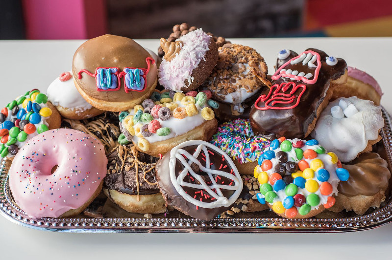plate of colourful doughnuts