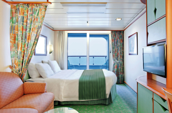 A balcony stateroom on board the Voyager of the Seas cruise ship.