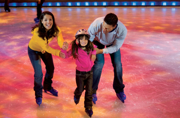 A family ice-skating on board the Voyager of the Seas cruise ship.