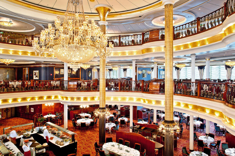 The elegant main dining room on board Royal Caribbean's Voyager of the Seas cruise ship.