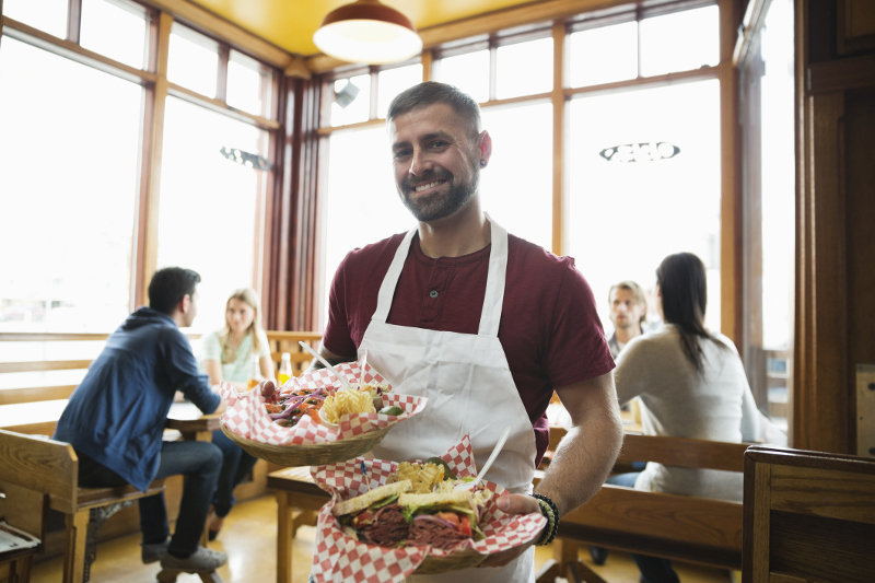 American waiter, working for tips