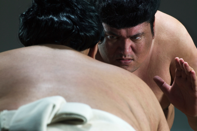 A close-up of sumo wrestlers.