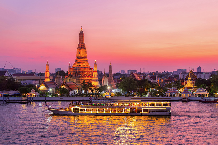 River cruise sailing past Wat Arun at sunset - why book a river cruise now