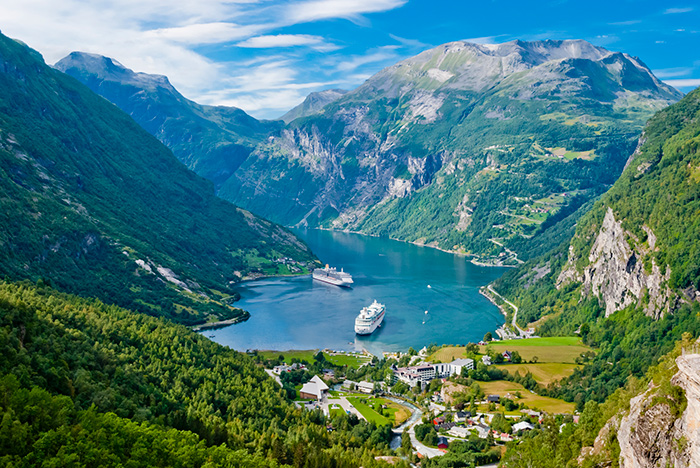 cruise ships docking in Geiranger Fjord, Norway
