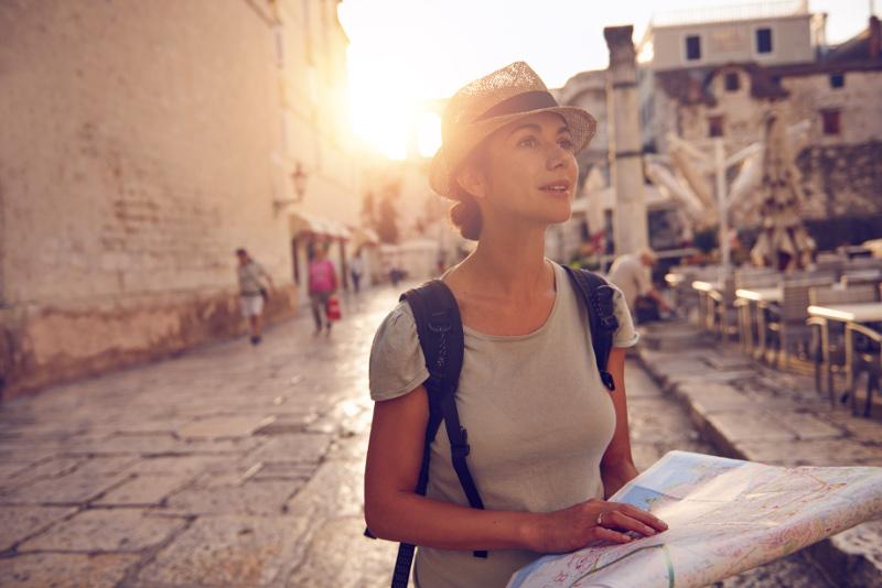 Woman looking at map in Croatia.