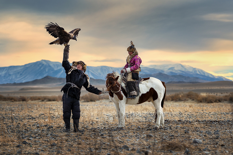 A local couple on horseback in Mongolia