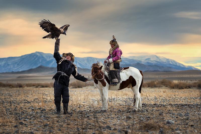 A local couple on horseback in Mongolia