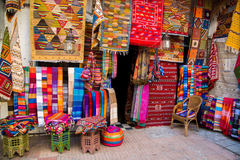 Beautiful textiles draw the eye in a Moroccan market.
