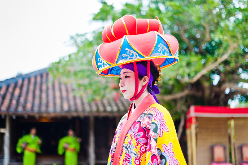 A woman in tradtiional dress in tropical Okinawa, Japan.