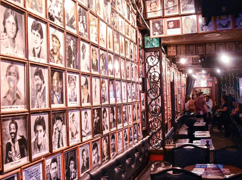 Inside Zaines Comedy Club with pictures of comedians all over the walls