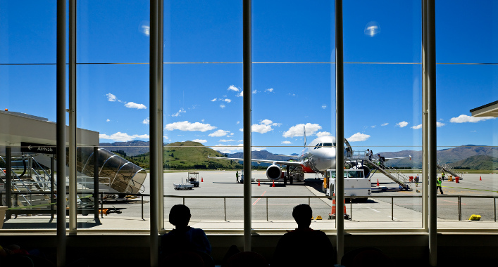 Travellers at Queenstown Airport, New Zealand, waiting to board a flight