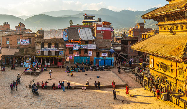Kathmandu ancient temples illuminated by golden sunset panorama Bhaktapur Nepal